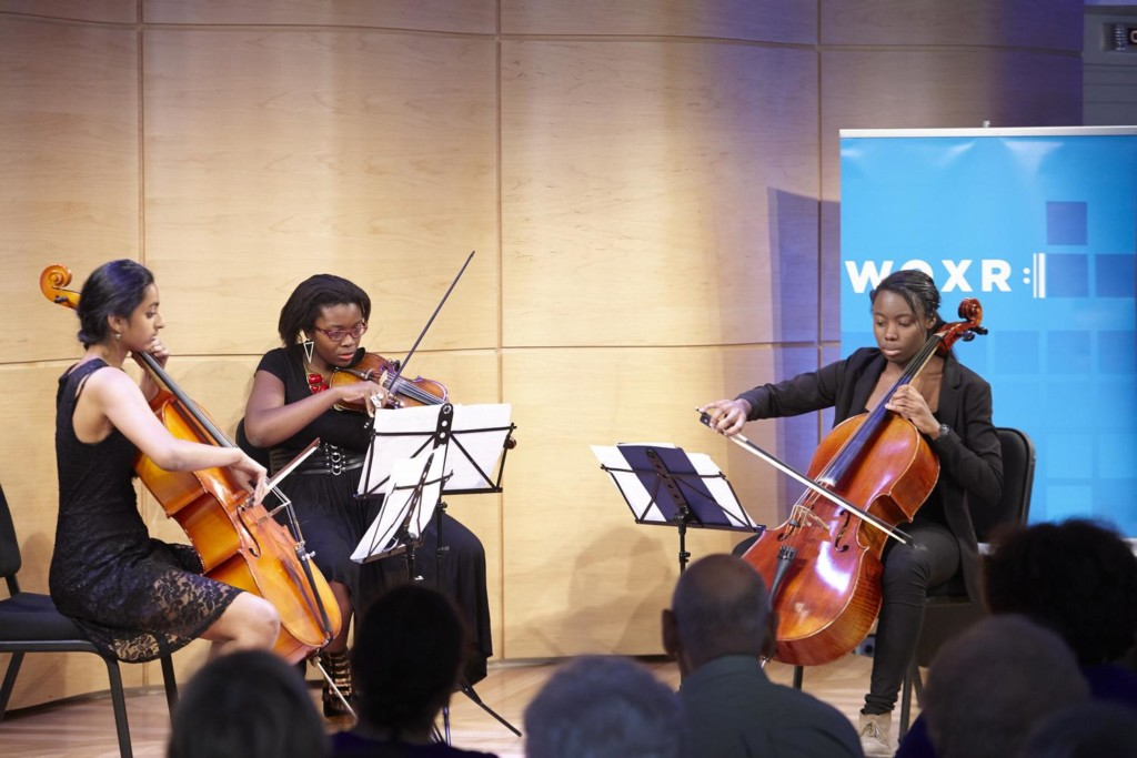 Students from the Summer Arts Institute play instruments donated to WQXR's drive during a concert in The Greene Space.